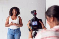 female-videographer-recording-woman-recording-podcast-in-studio.jpg