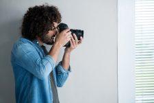 photographer-with-digital-camera-in-studio.jpg